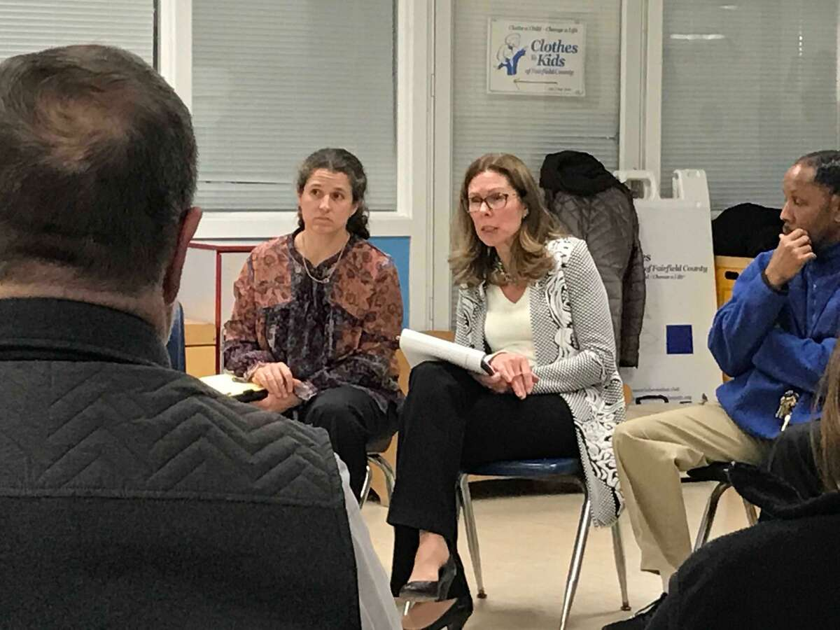 Rebecca Neuburger (left) and Charlotte Lansinger from the Police Executive Research Forum listening to residents at the Yerwood Center about what sort of new police chief Stamford should hire.