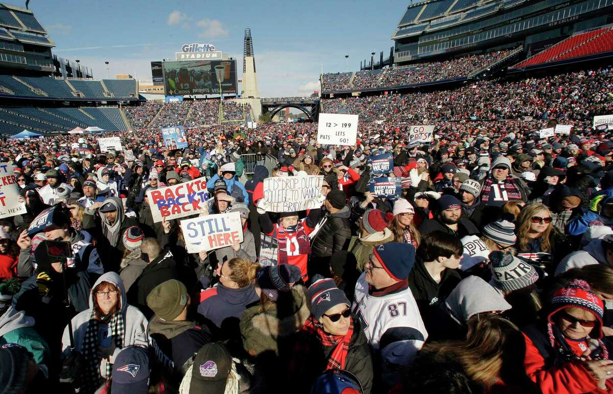 New England Patriots fans hold placards and cheer during an NFL football Super Bowl send-off rally for the team, Sunday, Jan. 27, 2019, in Foxborough, Mass. The Los Angeles Rams are to play the Patriots in Super Bowl on Feb. 3, in Atlanta, Ga. (AP Photo/Steven Senne)