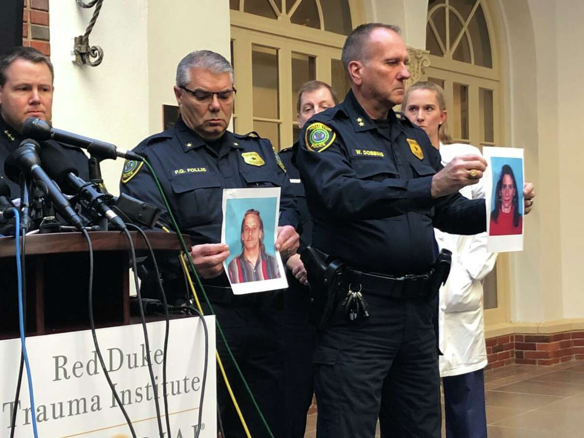 HPD officers show photos of two suspects killed in a Monday, Jan. 28 drug raid in Houston.