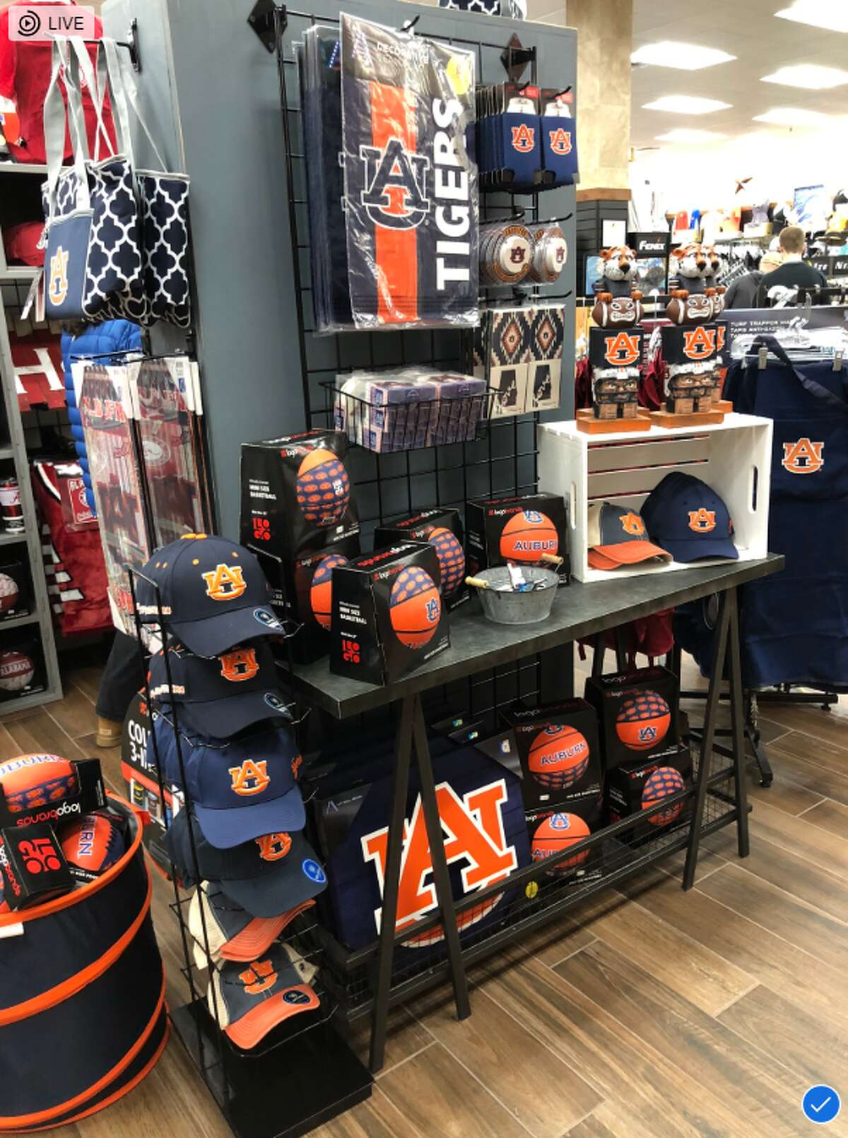 """The new Buc-ee's store in Alabama offers merchandise exclusive to the state, including Buc-ee's """"Beach Express"""" shirts and Crimson Tide gear."""