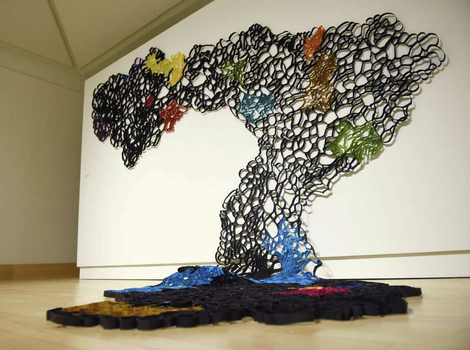 "Suzan Shutan's 2019 site-specific piece ""Drift"" is displayed in the ""Fluid Terrain"" exhibit which opens Thursday evening at the Greenwich Library's Flinn Gallery. The show features works by Laura Fayer, Amy Genser, and Suzan Shutan, who use paper and paint to present their interpretations of the natural world. The work is abstract but hints at presentations of land, sky, and sea terrain. Photo: Tyler Sizemore / Hearst Connecticut Media / Greenwich Time"