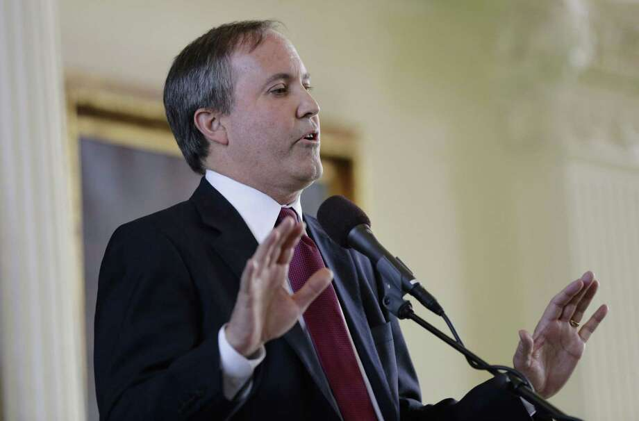 "Texas Attorney General Ken Paxton announced last Friday that the Texas Secretary of State's office discovered that about 95,000 people identified by the state Department of Public Safety as ""non-U.S. citizens"" have a matching voter registration record in Texas. By Tuesday, however, it appeared that many of those on the list were, in fact, U.S. citizens and the secretary of state's office was calling local officials to remove tens of thousands of names from the original list. Photo: Eric Gay /Associated Press / Internal"