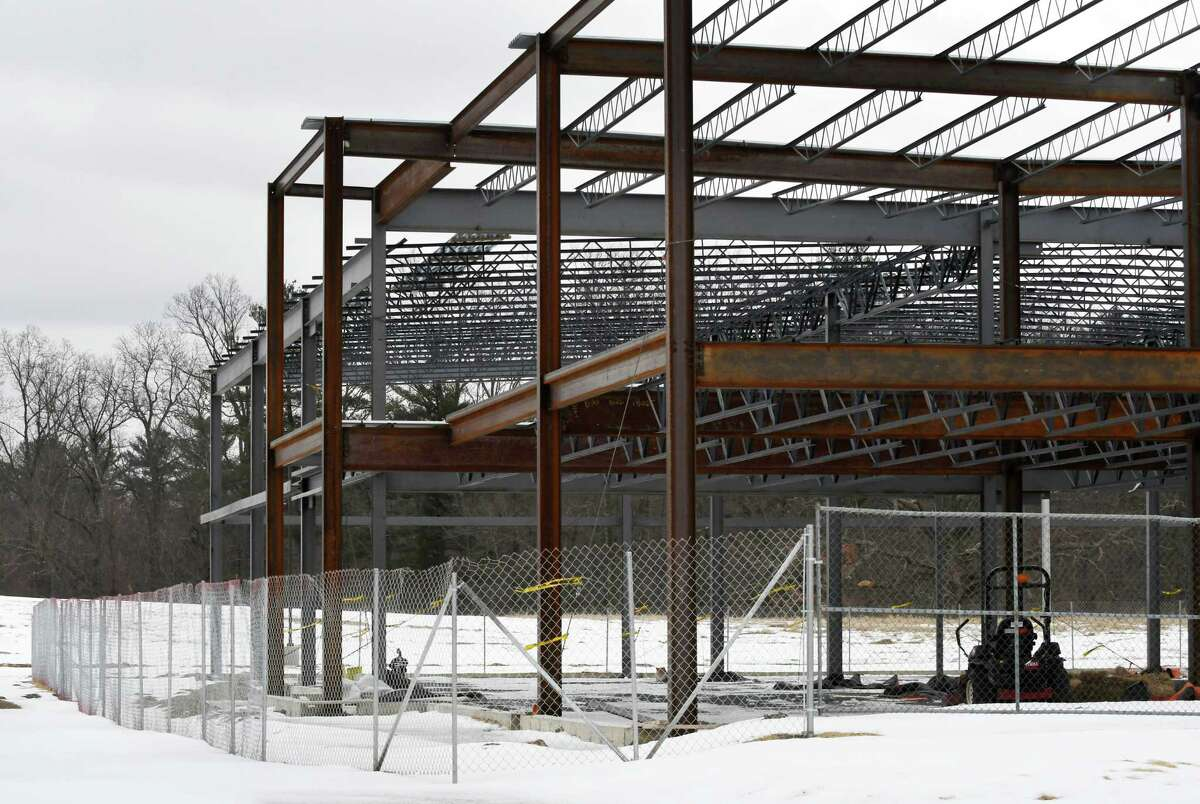 BBL has a erected a fence around the Monolith Solar construction site on Tuesday, Jan. 29, 2019, at the Vista Technology Campus in Slingerlands, N.Y. Monolith abruptly stopped construction of the $4.9 million headquarters building back in September around the same time it furloughed more than 50 workers. Pioneer Bank has sent town a notice of default on the now abandoned construction project. (Will Waldron/Times Union)