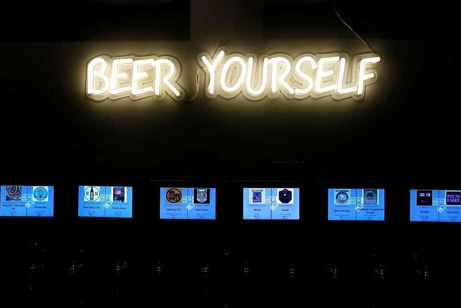 "The Brew Coop's ""Beer Yourself"" neon sign. Photo: Scott Strazzante / The Chronicle"