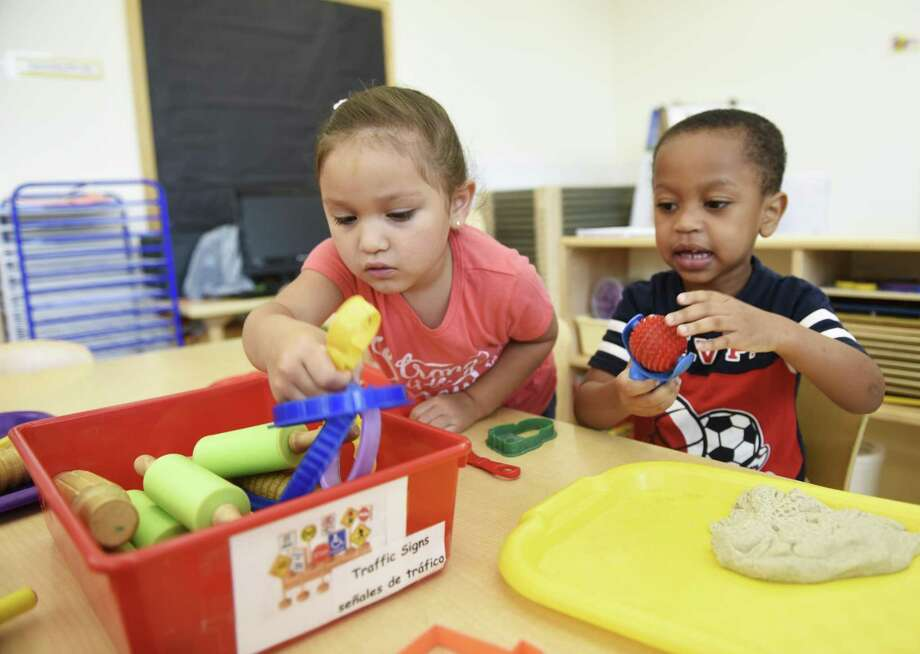 Preschool students Stephanie A. and Dawnes V. play during preschool welcome week at the Children's Learning Centers of Fairfield County William Pitt branch in August. Photo: Tyler Sizemore / Hearst Connecticut Media / Greenwich Time
