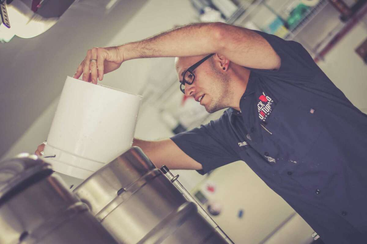 Back Unturned Brewing Co. owner and brewmaster Ricardo Garcia prepares a batch of beer. Garcia has been brewing beer for eight years.