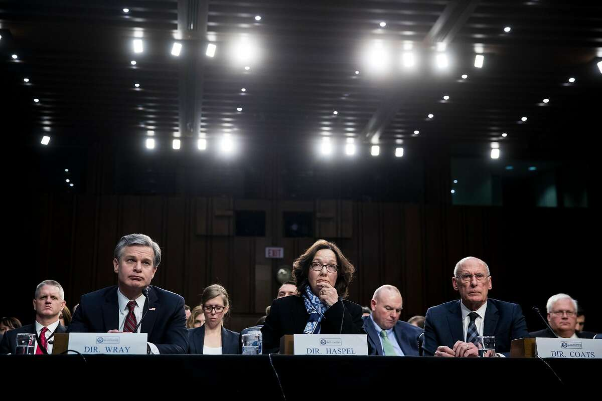 """From left: FBI Director Christopher Wray, CIA Director Gina Haspel and National Intelligence Director Dan Coats testify at a hearing with the Senate Intelligence Committee on Capitol Hill, in Washington, Jan. 29, 2019. North Korea is """"unlikely to give up"""" its nuclear stockpiles and Iran is not trying to develop nuclear weapons, a new intelligence assessment says, directly challenging the president's assertions. (Sarah Silbiger/The New York Times)"""