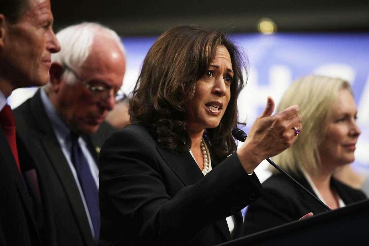 WASHINGTON, DC - SEPTEMBER 13: U.S. Sen. Kamala Harris (D-CA) (C) speaks on health care as Sen. Bernie Sanders (I-VT) (2nd L) listens during an event September 13, 2017 on Capitol Hill in Washington, DC. Sen. Sanders held an event to introduce the Medica