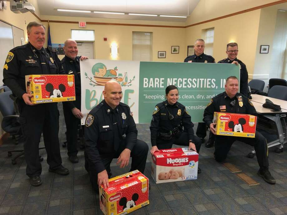 Shoreline police departments are holding their annual diaper drive during the month of February. Back row, standing, from left, are Sgt. Jeremiah Dunn, Chief Vincent DeMaio (Clinton); Deputy Chief Warren Hyatt (Guilford); Captain Joseph Race (Madison). Front row, from left, are Officer Douglas Harkins (Madison); Sgt. Corianne Dionne (Branford); Lieutenant Timothy Bernier (Guilford). Photo: Contributed Photo /
