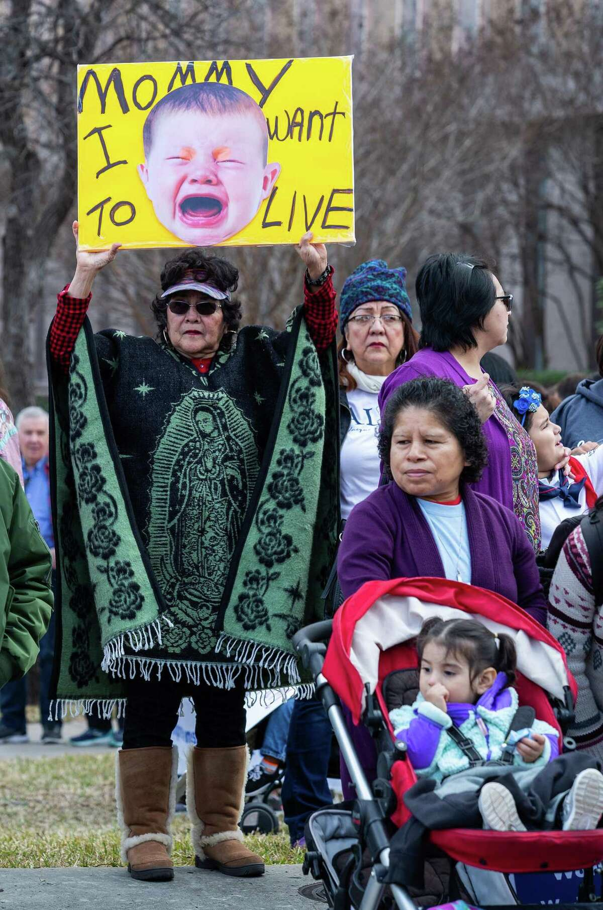 Lupe Rojas, from San Antonio, held up a sign before the start of the march during the Texas Rally for Life at the Texas State Capitol on January 26, 2019 in Austin, Texas.