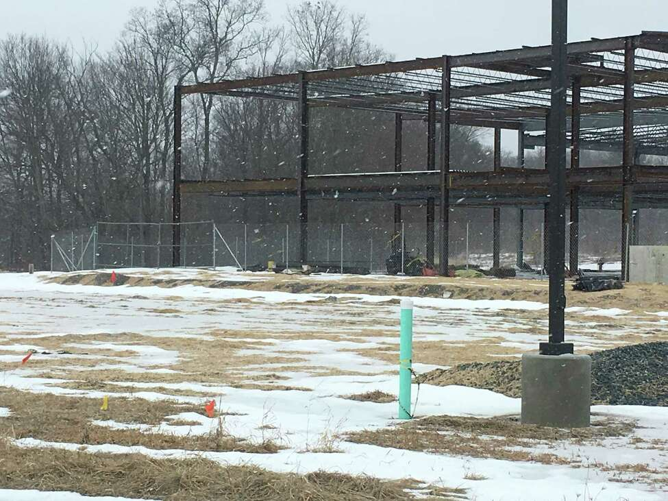 BBL Construction has put a fence around the Monolith Solar headquarters construction site after the company halted the project due to financial woes.