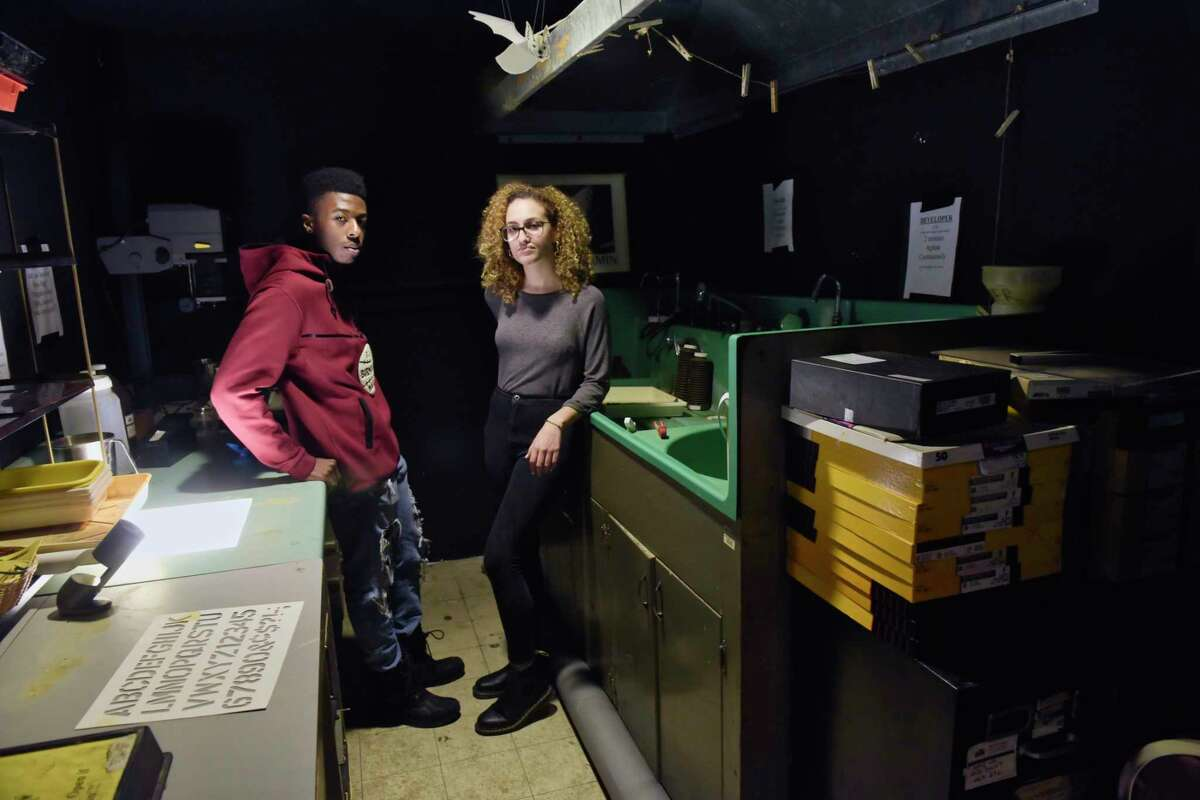 Jarron Childs, left, the vice president of the University Photo Service student organization, and Sabrina Flores, president of the student organization, pose inside the darkroom on the third floor of the Student Center at the University at Albany on Tuesday, Jan. 29, 2019, in Albany, N.Y. In the late 60's, students in the organization built the darkroom. The University at Albany administration wants to move the student organization out of their photo studio and photo darkroom location and into a much smaller space. (Paul Buckowski/Times Union)