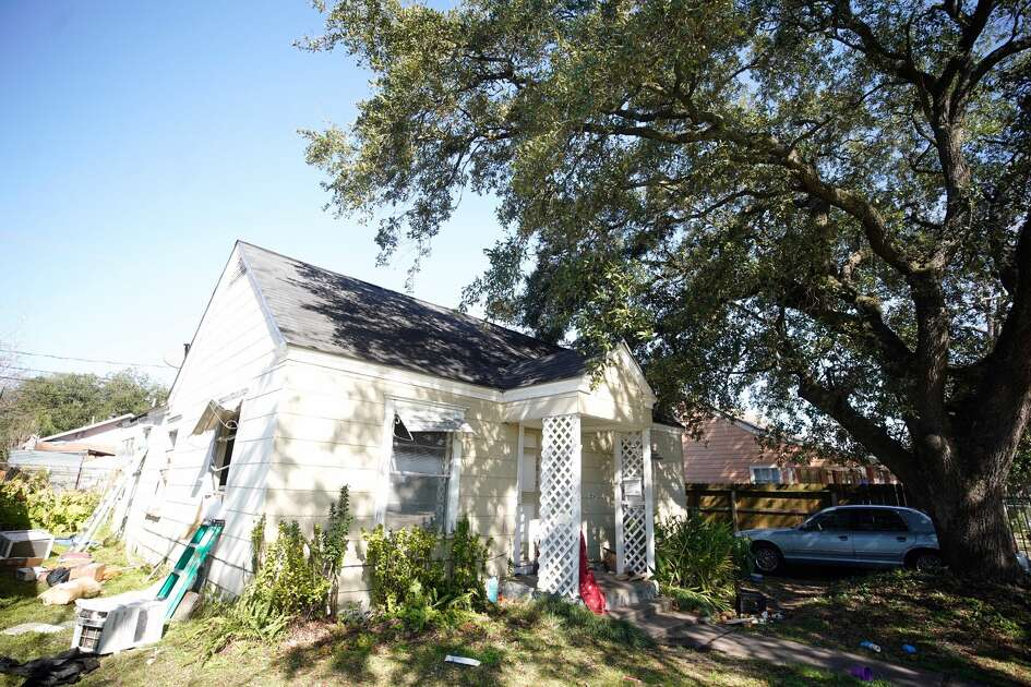 The home at 7815 Harding is shown Tuesday, Jan. 29, 2019 where five Houston Police Officers were shot in a gun battle while serving a search warrant on Monday. Police identified the two suspects who died as Rhogena Nicholas, 58, and Dennis Tuttle, 59.