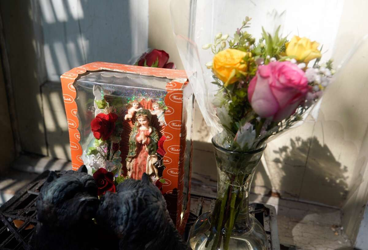 A small memorial of statues and flowers are shown at the front door of home at 7815 Harding Tuesday, Jan. 29, 2019 where five Houston Police Officers were shot in a gun battle while serving a search warrant on Monday. Police identified the two suspects who died as Rhogena Nicholas, 58, and Dennis Tuttle, 59.