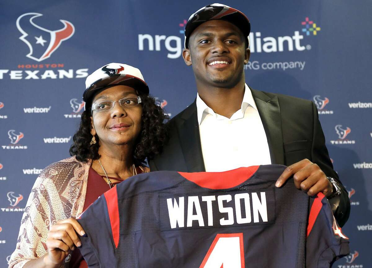 FILE - In this April 28, 2017, file photo, Houston Texans quarterback Deshaun Watson, right, poses with his mother Deann after an NFL football news conference in Houston. Watson's mother spent years encouraging him to chase his dreams. He has achieved one of his biggest goals of reaching the NFL. Now the Texans quarterback is giving back by renovating the home he grew up in and surprising his mom. (AP Photo/David J. Phillip, File)