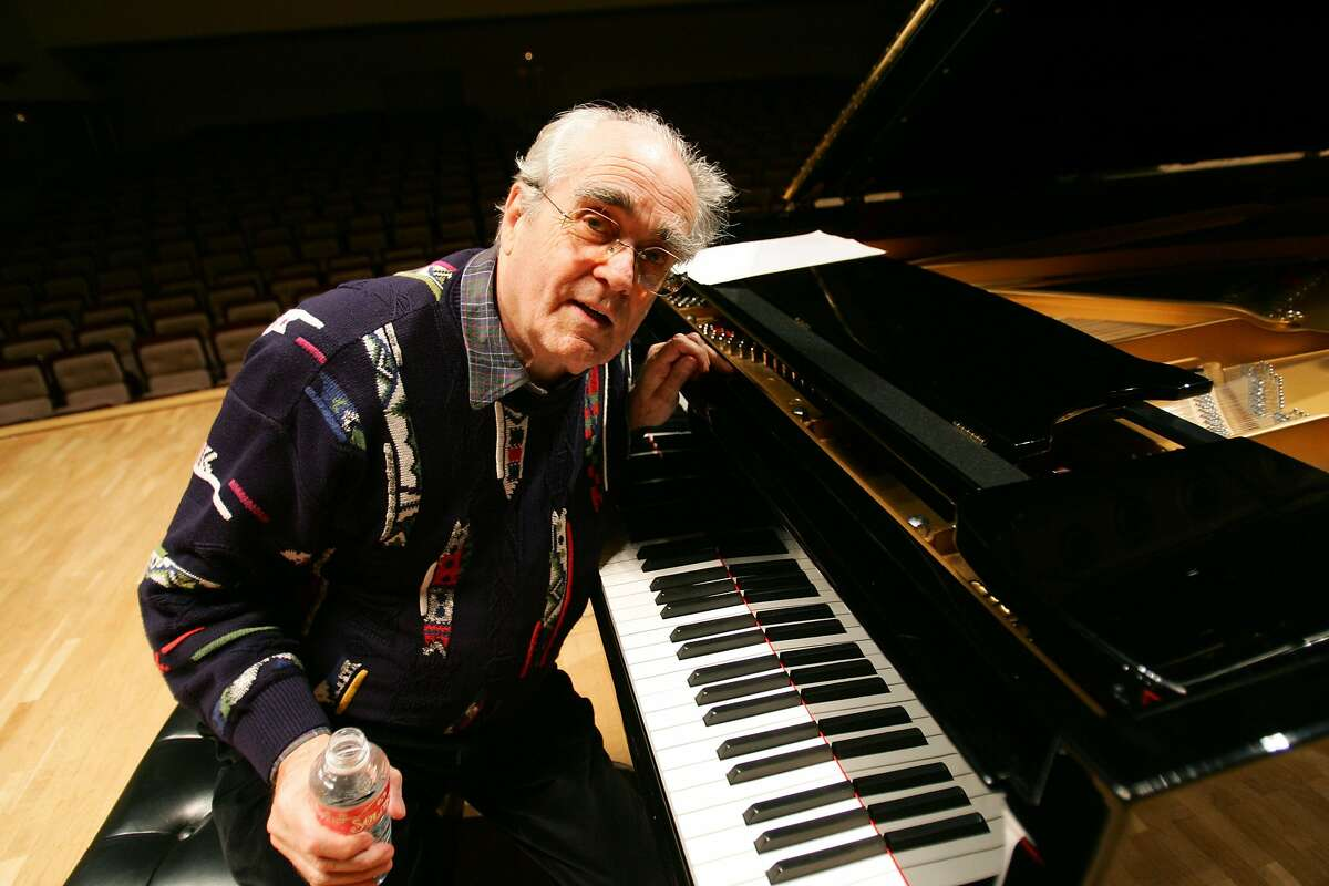 (FILES) In this file photo taken on November 9, 2005 French pianist Michel Legrand poses during a rehearsal with Cuban pianist Chucho Valdes before their joint concert in Madrid. - Legrand died aged 86, AFP reported on January 26, 2019. (Photo by Pierre-Philippe MARCOU / AFP)PIERRE-PHILIPPE MARCOU/AFP/Getty Images
