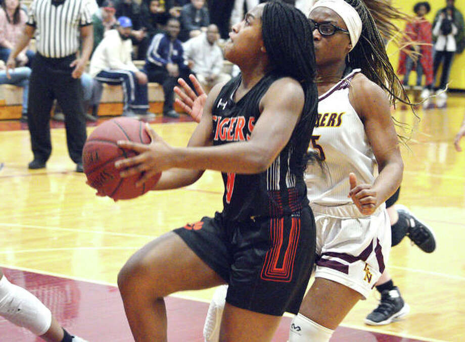 Edwardsville junior Quierra Love, left, drives to the basket during the third quarter of Monday's game at Lutheran North. Photo: Scott Marion | For The Telegraph