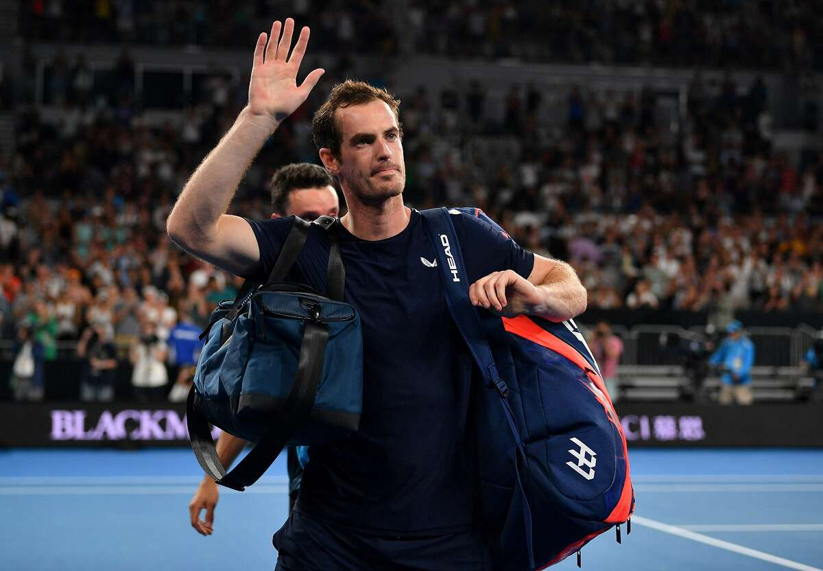 (FILES) In this file photo taken on January 14, 2019 Britain's Andy Murray waves to supporters after his defeat against Spain's Roberto Bautista Agut during their men's singles match on day one of the Australian Open tennis tournament in Melbourne. - Andy Murray has undergone hip resurfacing surgery in London, the British tennis great told his Instagram followers on January 29, 2019. The two-time Wimbledon champion had been weighing up the pros and cons of the operation, which involves putting a metal plate into the joint, in one last bid to prolong a career plagued by injury. (Photo by SAEED KHAN / AFP) / -- IMAGE RESTRICTED TO EDITORIAL USE - STRICTLY NO COMMERCIAL USE --SAEED KHAN/AFP/Getty Images