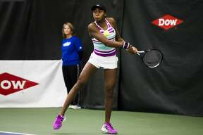Cori Gauff of Florida, 14, returns the ball during a match against Ashley Kratzer of California, 19, during the Dow Tennis Classic on Tuesday, Jan. 29, 2019 at the Greater Midland Tennis Center. (Katy Kildee/kkildee@mdn.net)