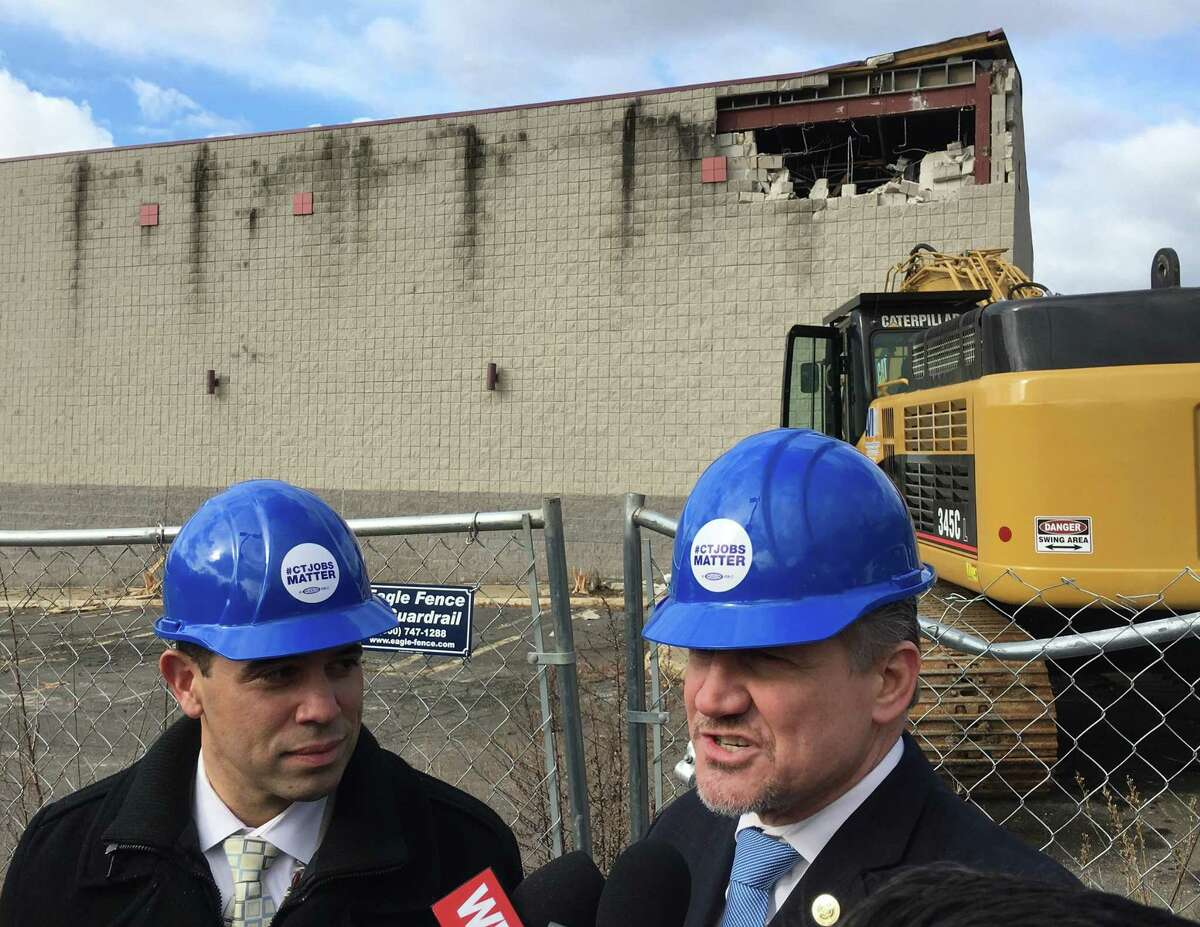 Rodney Butler, left, the Mashantucket Pequot chairman, and Kevin Brown, the Mohegan chairman, at the site of the old Showcase Cinemas in East Windsor on Monday, March 5, 2018. The Mashantucket Pequot and Mohegan tribes plan a casino at the site.