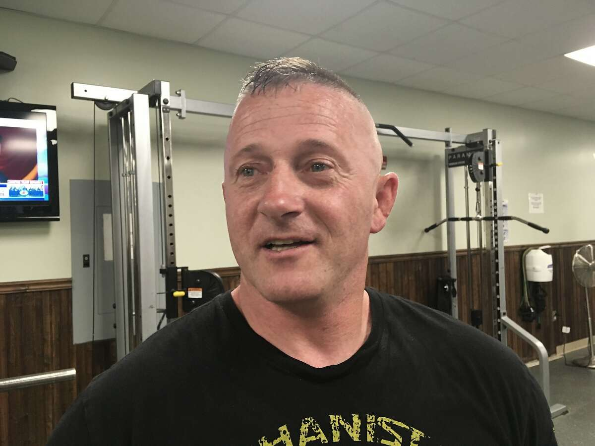 FILE - In this May 15, 2018 file photo, Richard Ojeda talks at a gym in Logan, W.Va. The retired Army paratrooper and West Virginia lawmaker who formalized his campaign for the presidency on Veterans Day 2018 is stepping down from the state Senate. Ojeda told news outlets that he's resigning as of next week because he doesn't want his seat to sit empty while he's campaigning for president in 2020. Republican Gov. Jim Justice will choose his replacement. (AP Photo/John Raby, File)