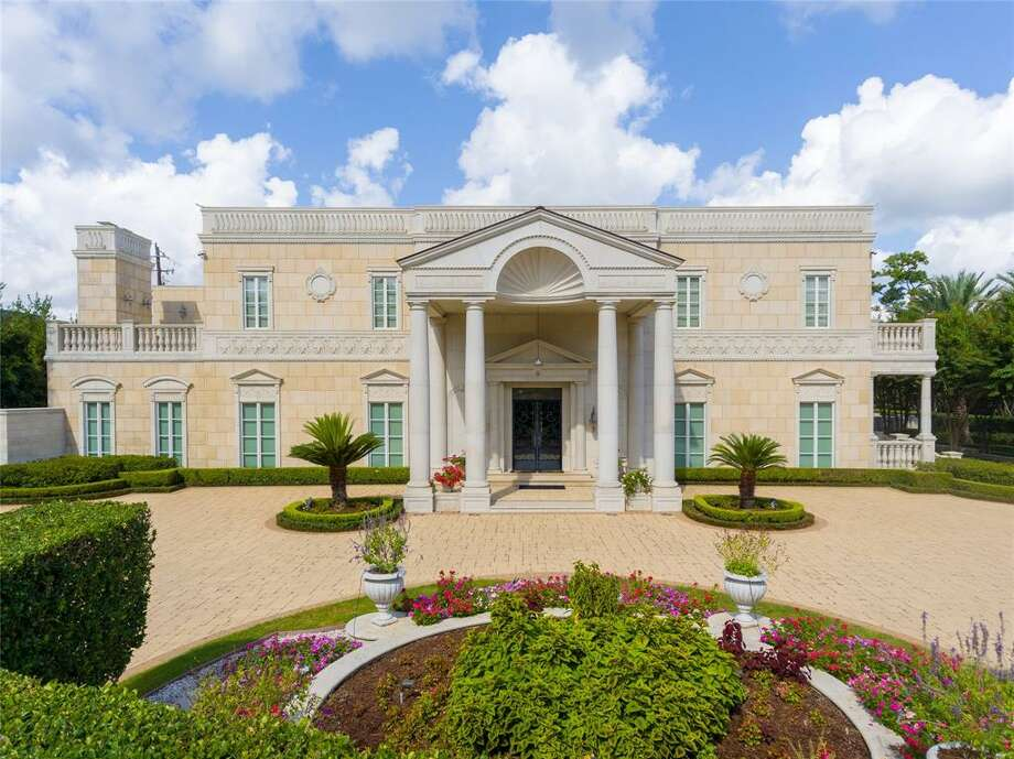 "This $9.75 million River Oaks estate slated for foreclosure looks like a miniature version of the Daddy Warbucks' mansion from ""Annie."" The property boasts an indoor heated swimming pool surrounded by bronze columns, Tiffany-style glass stained dome ceilings, sauna, wine cellar, marble flooring and a second story terrace that envelops the property. Photo: HAR/Claudia Fathivand/Nan And Company Properties Christie's International Real Estate"
