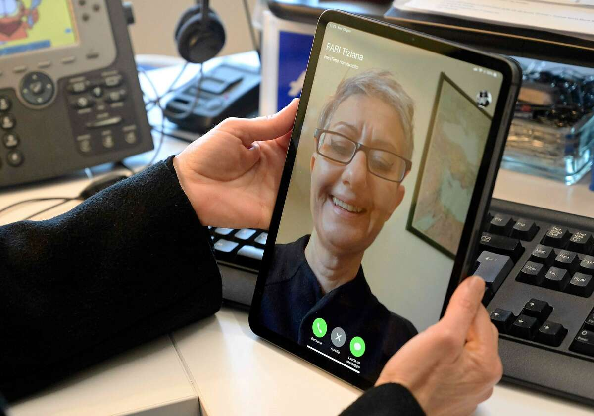 A woman uses her Ipad for a Facetime conversation, on January 29, 2019 in Rome. - A newly discovered FaceTime bug lets people hear and even see those they are reaching out to on iPhones using the video calling software, sparking privacy fears. (Photo by Vincenzo PINTO / AFP)VINCENZO PINTO/AFP/Getty Images