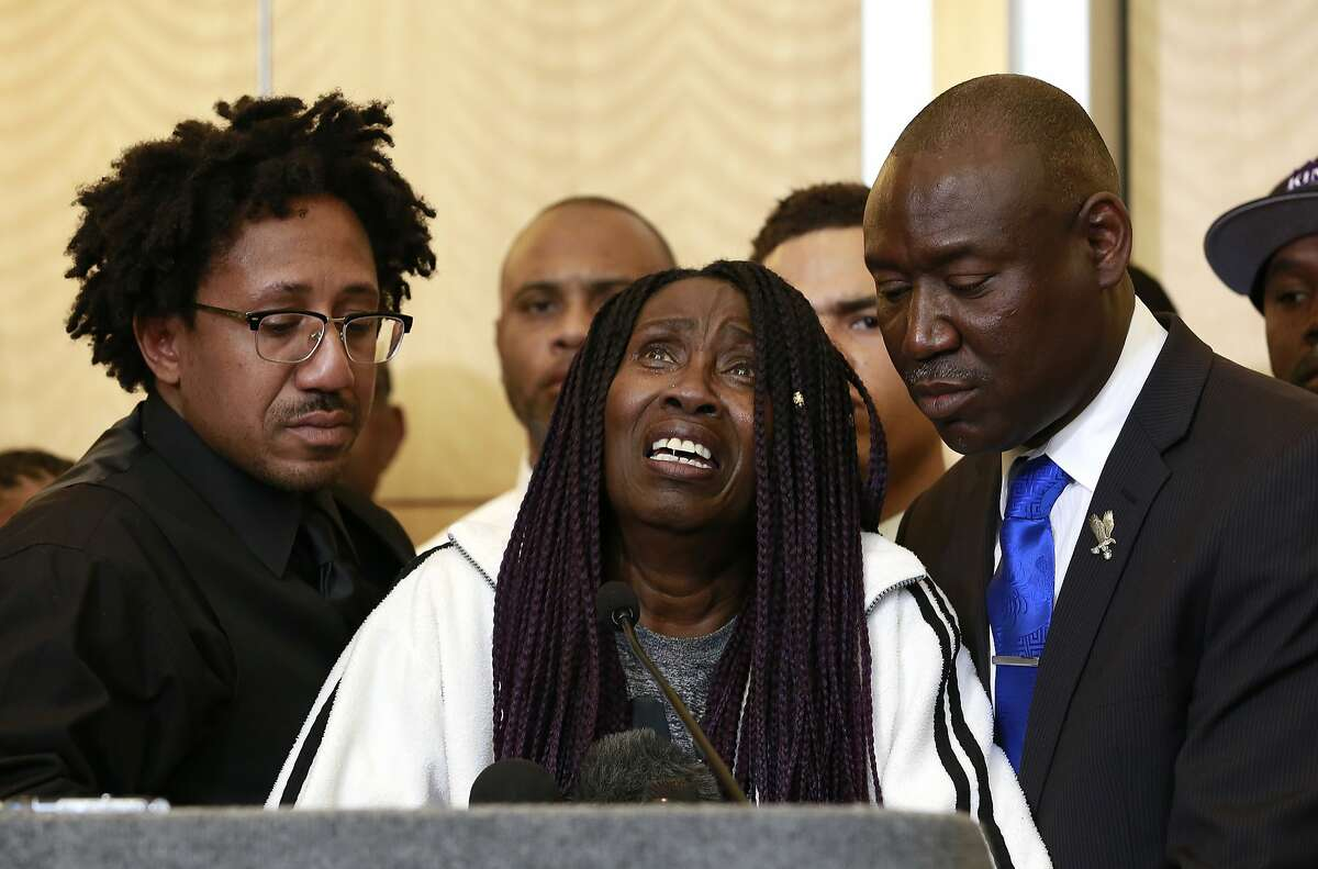 FILE -- In this March 26, 2018 file photo, a tearful Sequita Thompson, center, pauses as she discusses the March 2018 shooting death of her grandson, Stephon Clark by Sacramento Police, during a news conference, in Sacramento, Calif. The family of Clark, a 22-year-old unarmed black man killed by police in 2018, filed a wrongful death lawsuit Monday, Jan. 28, 2019, seeking more than $20 million from Sacramento and the two officers who opened fire. (AP Photo/Rich Pedroncelli, File)