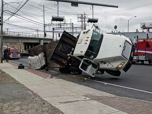 There were no injuries when a truck tipped over on Fairfield Avenue near Pine Street in Bridgeport, Conn., on Jan. 29, 2019. Photo: Contributed Photo / Contributed Photo / Connecticut Post Contributed