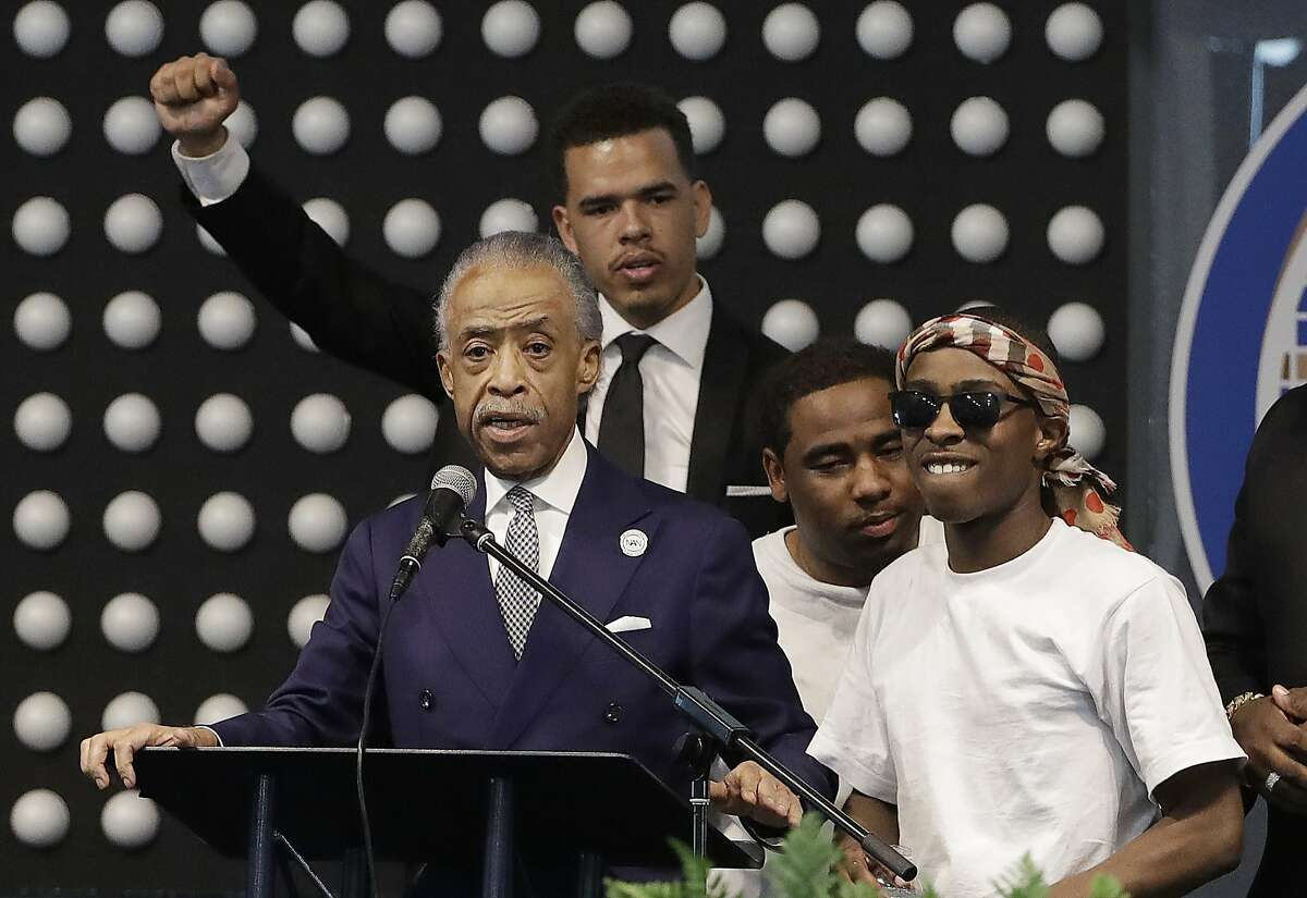Rev. Al Sharpton, left, speaks next to Stevante Clark during the funeral services for police shooting victim Stephon Clark at Bayside Of South Sacramento Church in Sacramento, Calif., Thursday, March 29, 2018. Clark, who was unarmed, was shot and killed by Sacramento Police Officers, Sunday, March 18. (AP Photo/Jeff Chiu, Pool)