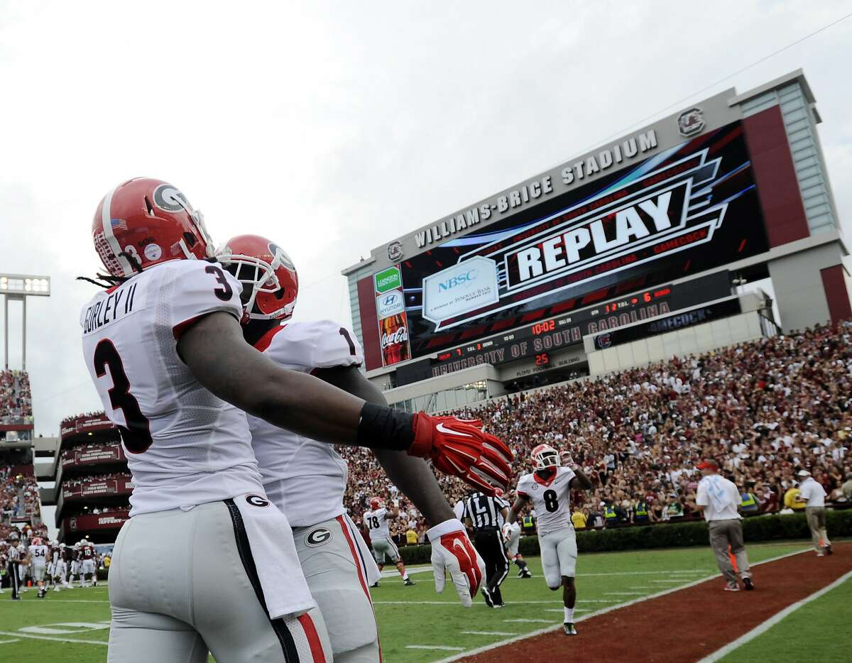 FILE- In this Sept. 13, 2014, file photo, Georgia running back Sony Michel (1) celebrates with teammate Todd Gurley (3) after scoring a touchdown against South Carolina during the first half of an NCAA college football game in Columbia, S.C. Sony Michel was a freshman and Todd Gurley a junior when the pair shared the backfield together at the University of Georgia. Sony Michel was a freshman and Todd Gurley a junior when the pair shared the backfield together at the University of Georgia. Now the former Bulldogs teammates will be on opposite sides when they meet in the Super Bowl. (AP Photo/Rainier Ehrhardt, File)