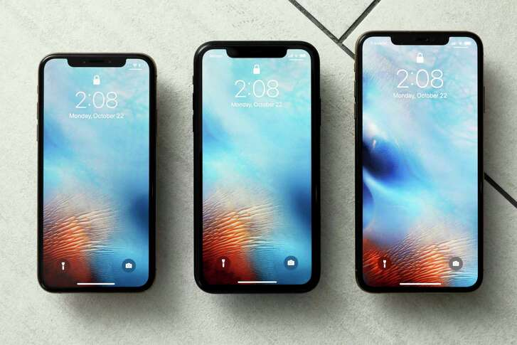 FILE - This Oct. 22, 2018, file photo shows the iPhone XS, from left, iPhone XR, and the iPhone XS Max in New York. Apple hoped to offset slowing demand for iPhones by raising the prices of its most important product, but that strategy seems to have backfired after sales sagged during the holiday shopping season.