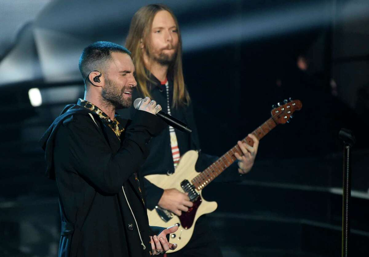 FILE - In this Sunday, March 11, 2018 file photo, Adam Levine, left, and James Valentine of Maroon 5 perform during the 2018 iHeartRadio Music Awards at The Forum in Inglewood, Calif. Maroon 5 has canceled its news conference to discuss the band's Super Bowl halftime performance, choosing to not meet with reporters as most acts have done during the week leading up to the NFL's big game. The NFL announced Tuesday, Jan. 29, 2019 that