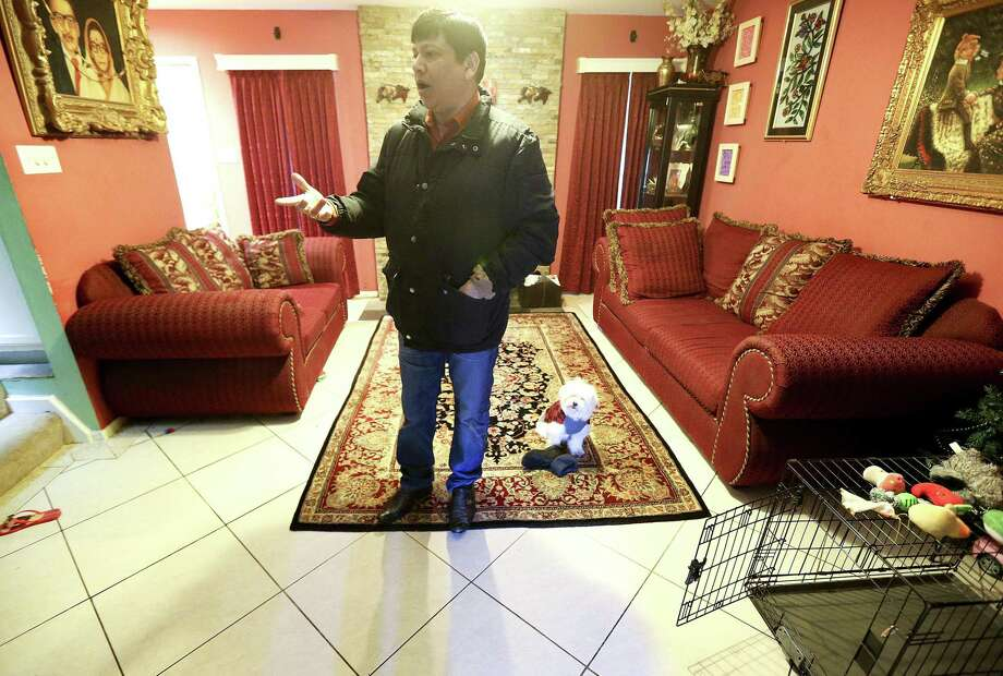 Ranjan Bhattacharjee talks about the damage to his home 17 months after Harvey on Sunday, Jan. 28, 2018 in Houston. Longterm, multi-billion-dollar programs will be rolling out soon and Bhattacharjee will be applying for that aid. Photo: Elizabeth Conley, Houston Chronicle / Staff Photographer / © 2018 Houston Chronicle