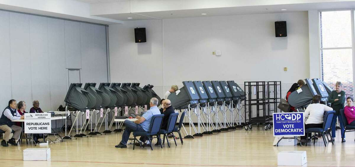 Voters take to the polls in the primaries in March. The ACLU and other groups slammed Texas elections officials who say they found 95,000 people identified as non-citizens who had a matching voter registration record. Texas Attorney General Ken Paxton now says many of them could have become citizens and voted legally. (Brett Coomer/Houston Chronicle via AP, File)
