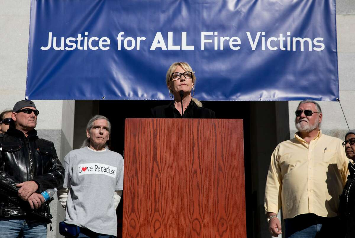 Activist and law clerk Erin Brockovich�speaks during a rally held by 2017 and 2018 fire victims and their lawyers calling for PG& accountability on the steps of the California State Capitol in Sacramento, Calif. Tuesday, Jan. 22, 2019.