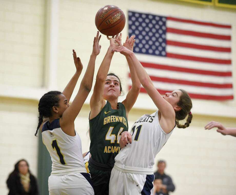 Greenwich Academy's Josephine Generuex (44) puts up a shot between Rye Country Day's Gabby Kelly (1) and Georgia Mandell (11) during the first half of an FAA high school girls basketball game Tuesday, Jan. 29, 2019 in Greenwich, Connecticut. Rye Country Day went on to defeat Greenwich Academy, 51-42 to remain undefeated in FAA league play. Photo: Matthew Brown / Hearst Connecticut Media / Stamford Advocate
