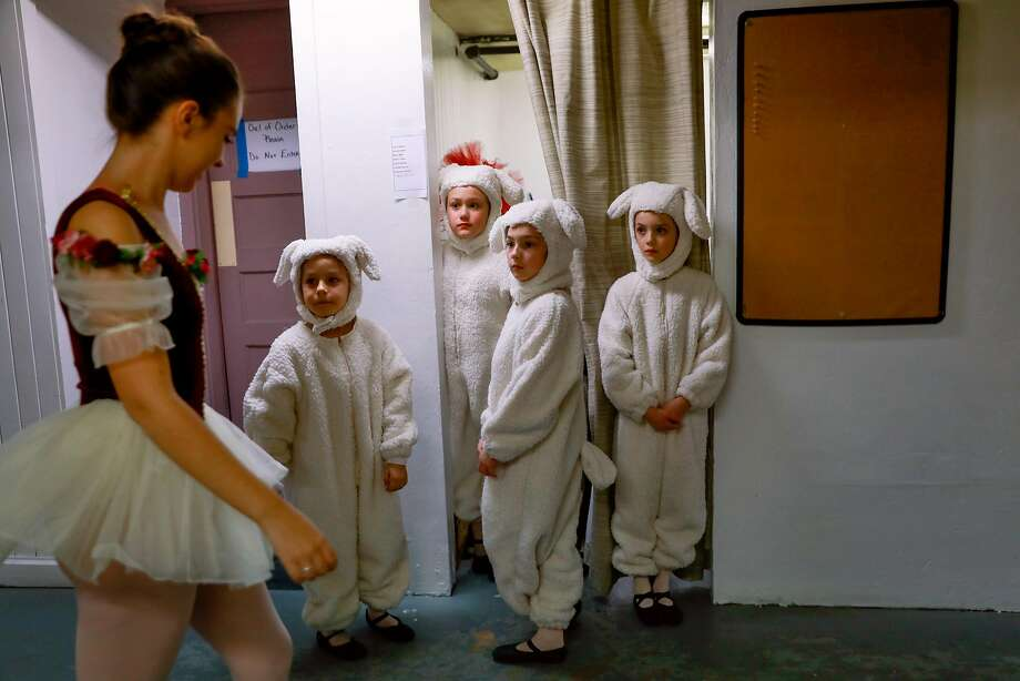 (l-r) Grace Rosendin (left) walks by Andrea Dwelle, 8, Caitlin Tooker, 9 Cordelia Barnett, 8, and Evelyn Spague, 9, who are dressed as sheep backstage during a rehearsal for the Nutcracker at the State Street Theater in Oroville, California, on Tuesday, Jan. 15, 2019.  Grace was one of many dancers who lost their home in Paradise during the Camp Fire. Photo: Photos By Gabrielle Lurie / The Chronicle