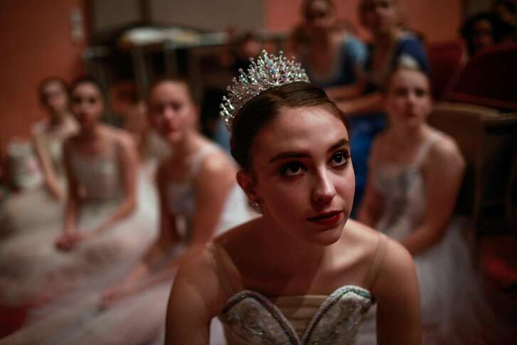 Ballerina Grace Rosendin (center) listens to her director Trudi Angel (not pictured) as they go over changes that need to be made during rehearsals for the Nutcracker in Oroville, California, on Thursday, Jan. 17, 2019. Grace lost her home in Paradise during the Camp Fire. The ballet school was also destroyed.