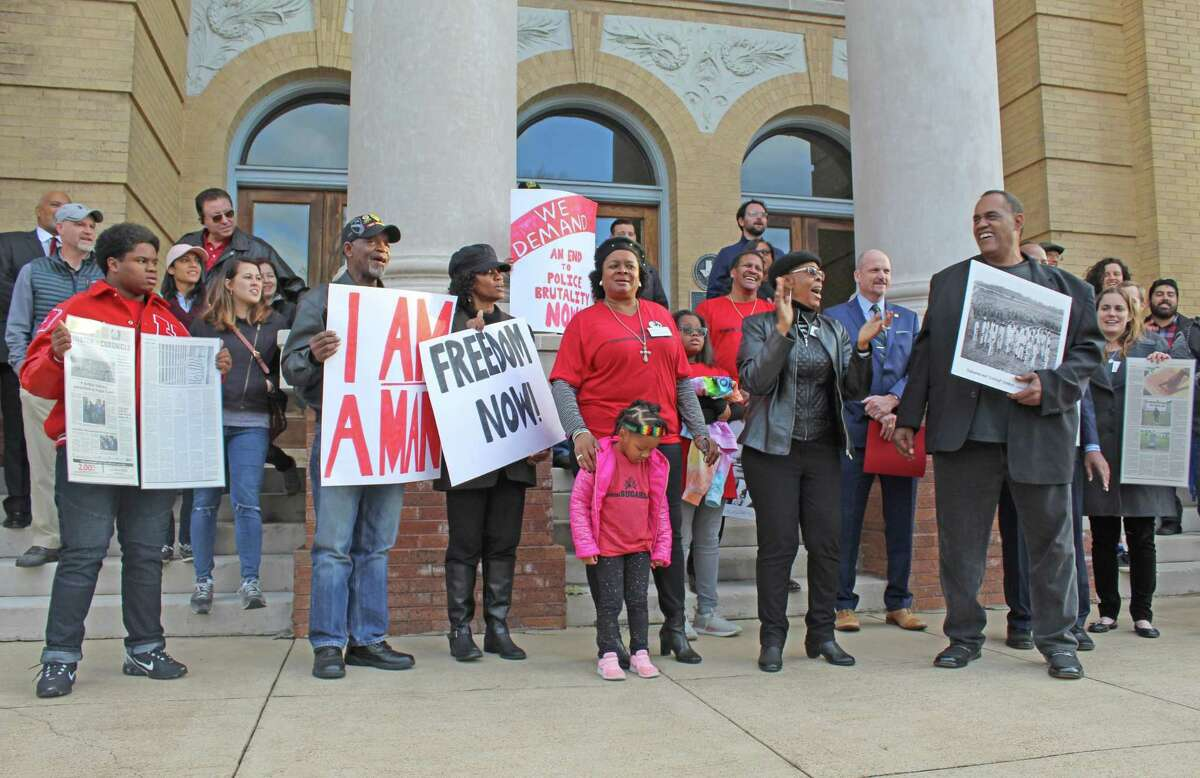Protesters gathered outside the Fort Bend County Courthouse on Martin Luther King, Jr. Day to rally against plans to re-locate the remains of 95 convict prisoners found at a historic grave site in Sugar Land.