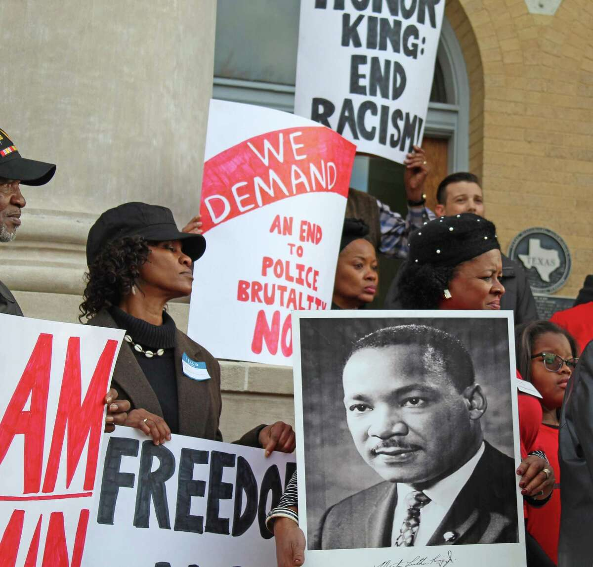 A group of protesters rallied outside the Fort Bend County Courthouse on Martin Luther King, Jr. Day against plans to re-locate the remains of 95 convict prisoners found at a historic grave site in Sugar Land.