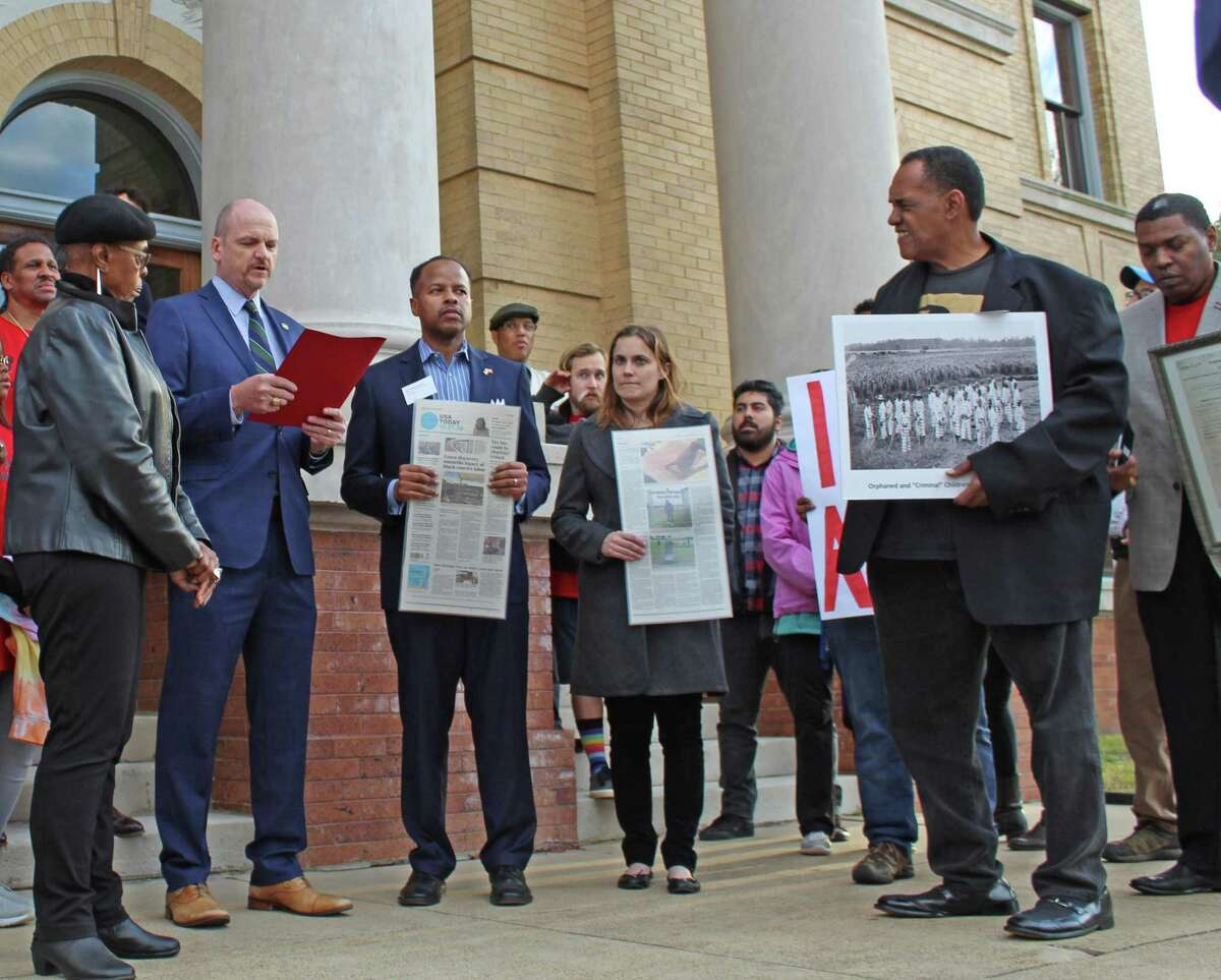 Fort Bend County Precinct 4 Commissioner Ken DeMarchant read a proclamation from County Judge KP George at the Martin Luther King, Jr. Day protest organized by the Convict Leasing and Labor Project.