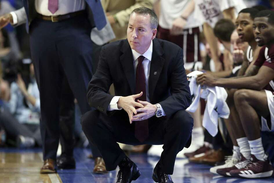 Texas A&M head coach Billy Kennedy watches his team during the second half of an NCAA college basketball game against Kentucky in Lexington, Ky., Tuesday, Jan. 8, 2019. Kentucky won 85-74. (AP Photo/James Crisp)