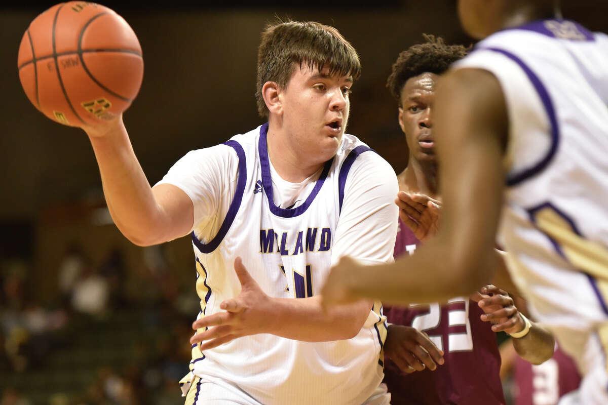Midland High's Brett Canis (34) passes against Lee Jan. 29, 2019, at Chaparral Center. James Durbin / Reporter-Telegram