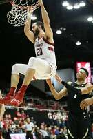 Stanford Cardinal center Josh Sharma (20) dunks in the second half of an NCAA basketball game against the Colorado Buffaloes at Maples Pavilion on Saturday, Jan. 26, 2019, in Stanford, Calif. The Cardinal won 75-62.