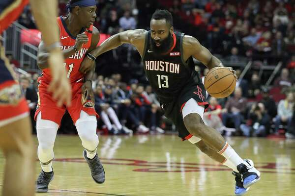 1of35PHOTOS  Former Texas high school stars in the NBA Houston Rockets  guard James Harden (13) drives around New Orleans Pelicans guard Jrue  Holiday (11) ... d2042bde3
