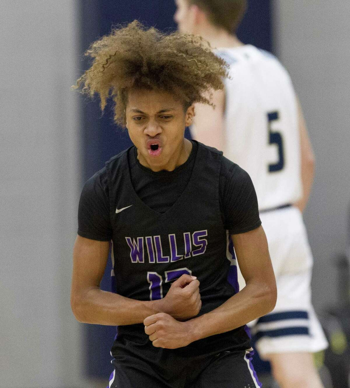 Willis point guard D'Shawn Woods (13) reacts after making a three-pointer to end the second quarter of a District 20-5A high school basketball game, Tuesday, Jan 29, 2019, in Montgomery.