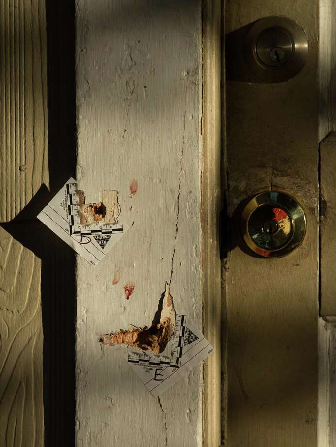 Seventeen bullet holes can be seen on the front entrance of 7815 Harding Street, where five Houston Police officers were shot while serving a warrant Tuesday, Jan. 29, 2019, in Houston. Photo: Godofredo A. Vasquez,  Houston Chronicle / Staff Photographer / 2018 Houston Chronicle