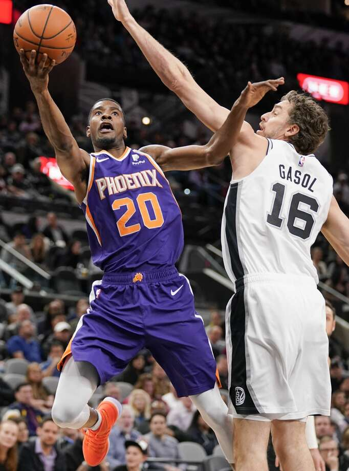 Phoenix Suns' Josh Jackson (20) shoots against San Antonio Spurs' Pau Gasol during the first half of an NBA basketball game, Tuesday, Jan. 29, 2019, in San Antonio. (AP Photo/Darren Abate) Photo: Darren Abate/Associated Press