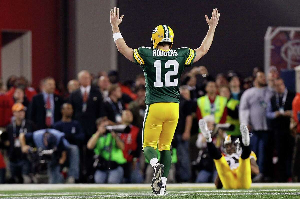 ARLINGTON, TX - FEBRUARY 06: Aaron Rodgers #12 of the Green Bay Packers celebrates after a touchdown pass to Greg Jennings against the Pittsburgh Steelers during Super Bowl XLV at Cowboys Stadium on February 6, 2011 in Arlington, Texas. (Photo by Kevin C. Cox/Getty Images)